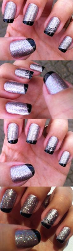 silver nails with black tips and nail tattoos