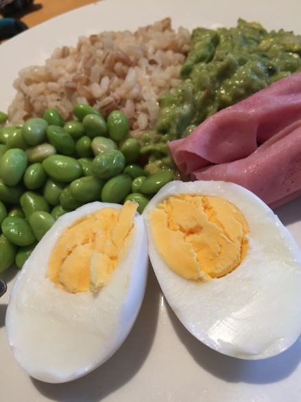 Three grain rice, turkey ham, edamame beans, chunky guacamole and egg