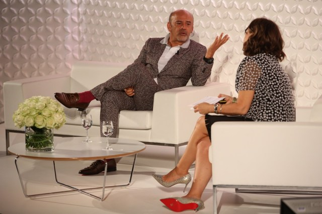 Christian Louboutin talks to  Alexandra Schulman, Vogue editor. Image from Vogue Uk, Darren-Gerrish