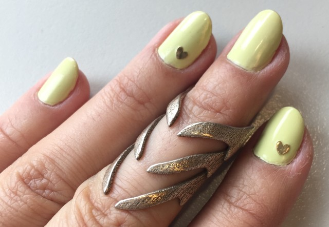 yellow nails with gold heart sticker