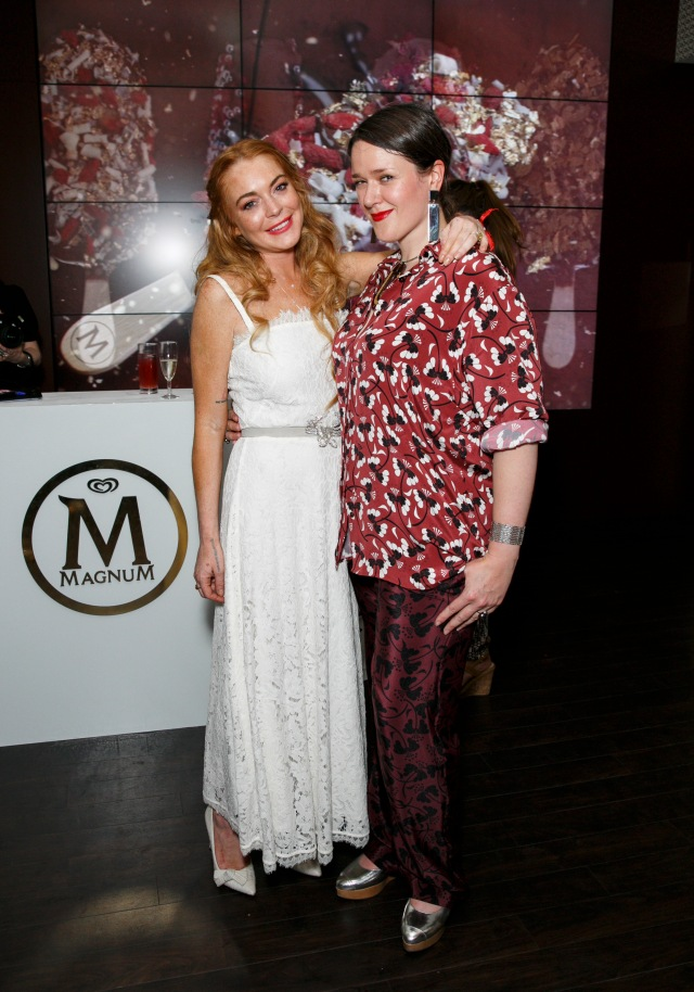 Lindsay Lohan and Holly Fulton attend the launch party for the Magnum Pleasure Store in LondonÕs Covent Garden. PRESS ASSOCIATION Photo. Picture date: Wednesday July 1, 2015. To celebrate the storeÕs opening, Magnum has teamed up with designer Holly Fulton to create an exclusive necklace, incorporating Magnum through colour and design. Available to a select few competition winners, the necklace will be the key to a summer of unlimited freshly dipped ice creams at the Pleasure StoreÕs exclusive dipping bar. Photo credit should read: John Phillips/PA Wire