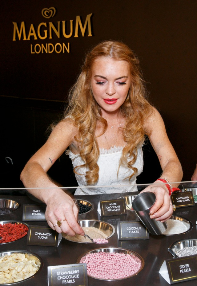 Lindsay Lohan attends the launch party for the Magnum Pleasure Store in London's Covent Garden. PRESS ASSOCIATION Photo. Picture date: Wednesday July 1, 2015. To celebrate the store's opening, Magnum has teamed up with designer Holly Fulton to create an exclusive necklace, incorporating Magnum through colour and design. Available to a select few competition winners, the necklace will be the key to a summer of unlimited freshly dipped ice creams at the Pleasure Store's exclusive dipping bar. Photo credit should read: John Phillips/PA Wire